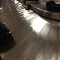 Photo taken at Baggage Claim by Glenn D. on 7/8/2012