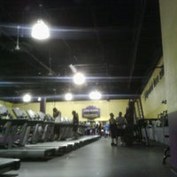 Photo taken at Planet Fitness by E- C. on 4/18/2012