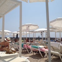 Photo taken at La Spiaggia Beach by Roberta N. on 7/20/2012
