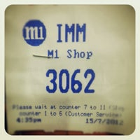 Photo taken at M1 Shop by Soh J. on 7/15/2012