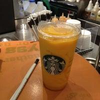 Photo taken at Starbucks by Nigel S. on 7/27/2012