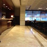 Photo taken at Sheraton Hotel Bar by Jeff P. on 3/11/2012