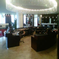 Photo taken at Laguna Palace Hotel by Roberto B. on 7/23/2012