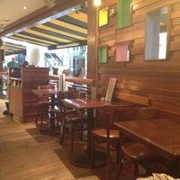 Photo taken at Grand Café Plaza by Roy A. on 7/22/2012