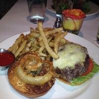Photo taken at Stella Manhattan Bistro by Tara B. on 4/3/2012
