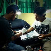 Photo taken at Ibud tattoo by Pitha P. on 2/19/2012