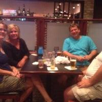 Photo taken at Mudsocks Grill by Bryan K. on 6/29/2012