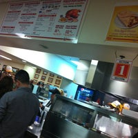 Photo taken at King Taco Restaurant by Angie C. on 2/12/2012