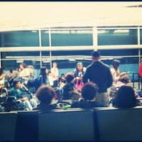 Photo taken at Gate A7 by Patrick S. on 7/2/2012