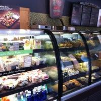 Photo taken at Starbucks by Alejandra G. on 6/23/2012