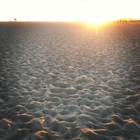 Photo taken at Huntington State Beach by R L. on 6/24/2012