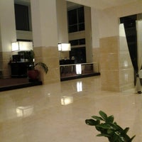 Photo taken at Sintesa Peninsula Hotel by Charlie R. on 6/30/2012