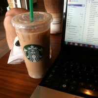 Photo taken at Starbucks by April on 7/1/2012
