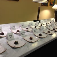 Photo taken at Michael Mischer Chocolates by Adriana K. on 2/19/2012