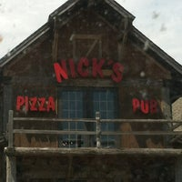 Photo taken at Nick's Pizza & Pub by Brittany A. on 5/25/2012