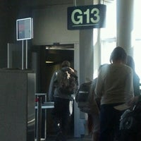 Photo taken at Gate G13 by Mandy S. on 4/11/2012