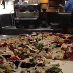 Photo taken at California Pizza Kitchen by ML H. on 7/4/2012