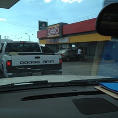 Photo taken at OXXO by Gustavo C. on 3/20/2012