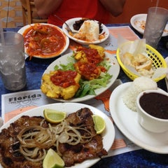 Photo taken at Latin Cafe on the beach by Brent S. on 9/5/2012