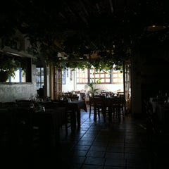 Photo taken at Koutouki Taverna by socialLITE y. on 2/15/2012