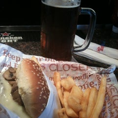 Photo taken at Red Robin Gourmet Burgers by Dave P. on 3/17/2012