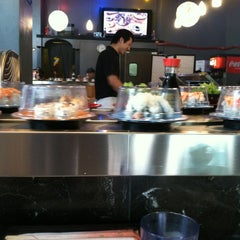 Photo taken at Sushi Sakura by Ashley E. on 3/17/2012