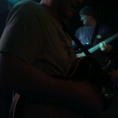 Photo taken at Tanqueray's Bar & Grille by Scott L. on 2/19/2012