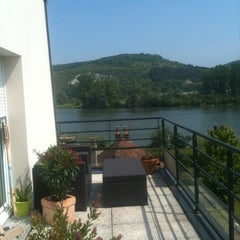 Photo taken at Bords de Seine by Aude H. on 5/27/2012