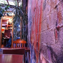 Photo taken at Sappho Books, Cafe & Wine Bar by Lewis L. on 11/26/2011
