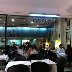 Photo taken at Marietta Café by Izanil C. on 12/22/2011