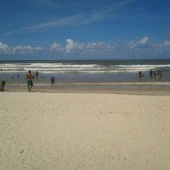 Photo taken at Praia Da Costa by Rianna A. on 2/21/2012