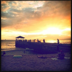 Photo taken at Waikiki Beach Walls by Devin J. on 8/17/2012