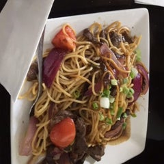 Photo taken at Mamita Peruvian Restaurant by Laura S. on 2/28/2015