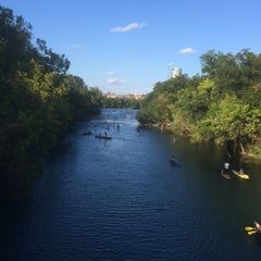 Photo taken at Barton Springs Pedestrian Bridge by Steve H. on 8/2/2014