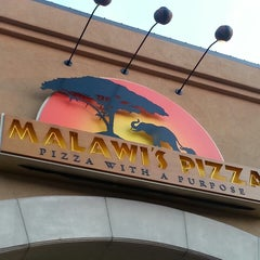 Photo taken at Malawi's Pizza by Jeremy N. on 7/19/2014