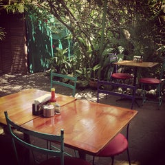 Photo taken at Café Milagro in Manuel Antonio by Josh O. on 5/7/2013
