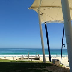 Photo taken at Scarborough Beach by Geoff K. on 3/28/2013