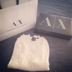 Photo taken at Armani Exchange by Aqua J. on 7/11/2014