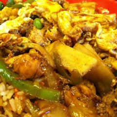 Photo taken at Genghis Grill by Jesse B. on 5/8/2013
