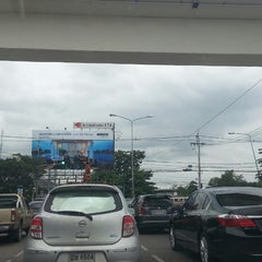Photo taken at แยกนิด้า (NIDA Intersection) by Arch M. on 7/26/2013