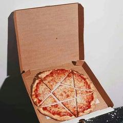 Photo taken at Hoek's Death Metal Pizza by Sean W. on 3/15/2013