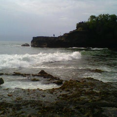 Photo taken at Tanah Lot Beach by Nidia ananda M. on 12/17/2012
