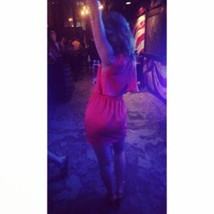 Photo taken at Coyote Ugly Saloon by Andrea N. on 3/7/2015