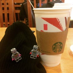 Photo taken at Starbucks by Charlie H. on 12/23/2014