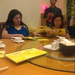 Photo taken at Laota Restaurant by Olivia C. on 8/11/2013