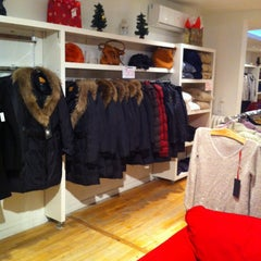 Photo taken at Boutique MUST by Marie-Claire A. on 12/21/2012