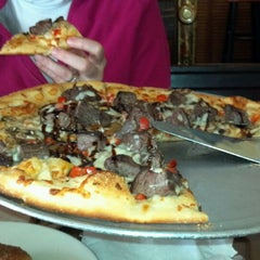 Photo taken at Blue Mountain Pizza by Britt F. on 1/5/2013