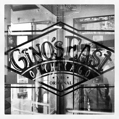 Photo taken at Gino's East by Joel D. on 11/23/2012