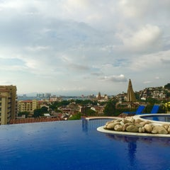 Photo taken at Selva Romantica infinity pool by Claudia G. on 7/26/2015