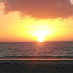 Photo taken at Pass-a-Grille Beach by Angel G. on 5/17/2013